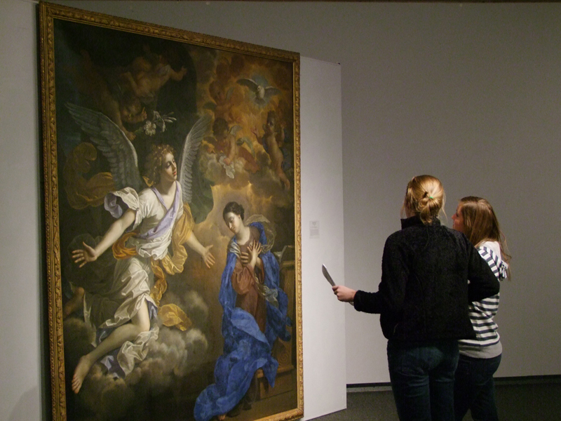 Students looking at Ringling Painting