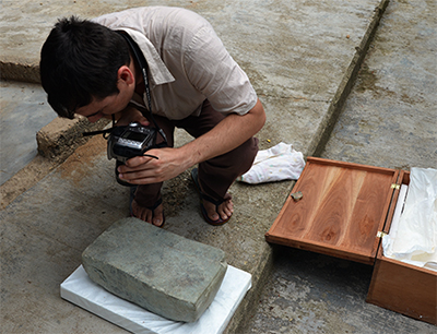 Carrasco photographing the Cascajal block, oldest known writing in New World.