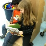 elementary students reading in chair