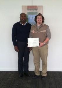 Sam receiving award