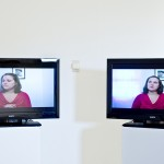 2 monitors in a gallery space