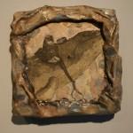 Etching of bird on stone