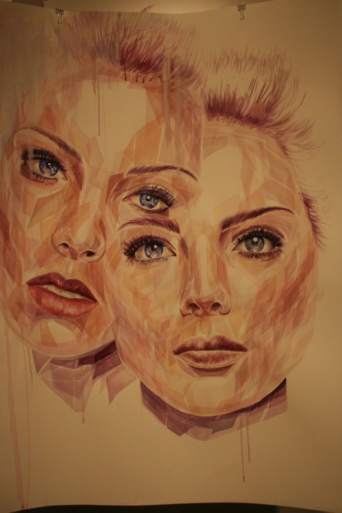 Painted Portraits composed of small skin colored polygons