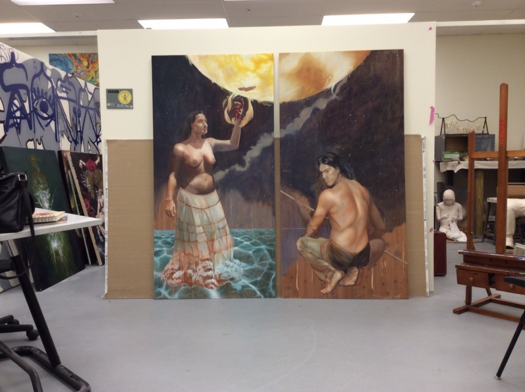 a studio space with a large painting in progress