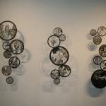 circular laser cut illustrations on a wall