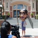 Emily Hernandez in large cardboard head