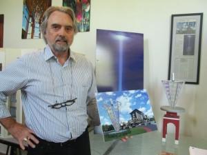 Ken Von Roenn showcasingartist's rendition of his steel-glass-light sculpture