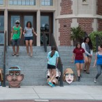 Students preparing for their demonstration with cardboard head