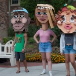 Angle shot of three students with cardboard heds