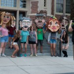 Students and cardboard heads get their photo taken in front of Westcott