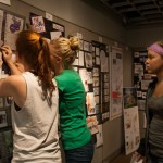 Angled shot of two girls hanging their project