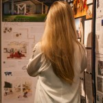 Back shot of girl looking at her project
