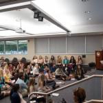 Angled shot of students listening to presentation