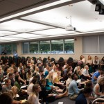 Angled shot of students listening to lecture