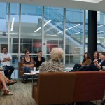 Back shot of group of graduate students listening to Jean Massing