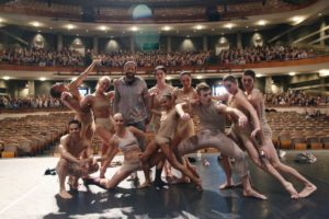"""Dancers surround """"American Crime"""" executive producer John Ridley, standing, third from left."""