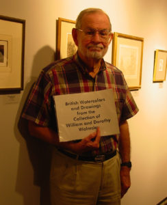 Bill Walmsley during and installation of prints and drawings from his collection