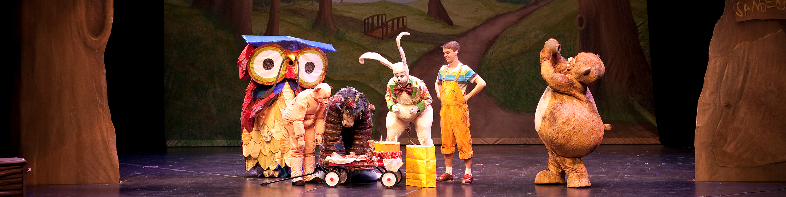 students performing Whinny the Poo on stage