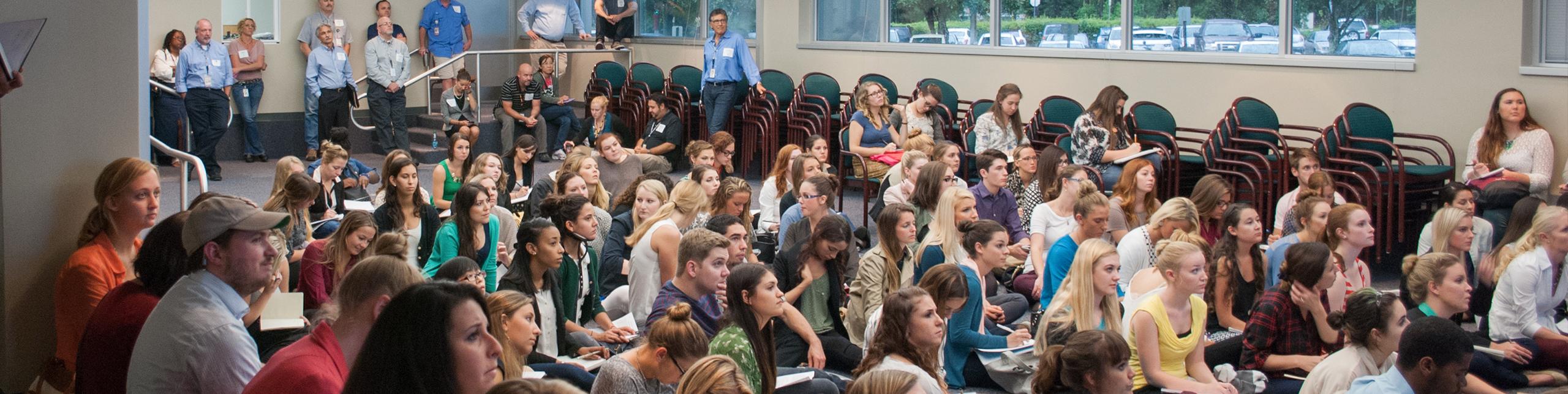students listenening to lecturer speak