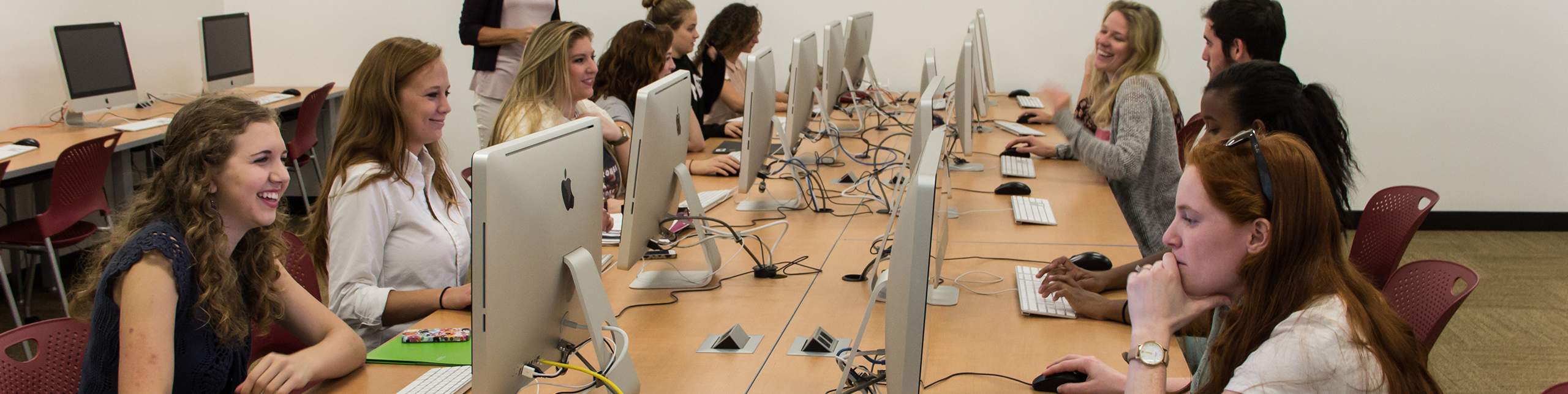 students designing art on computers