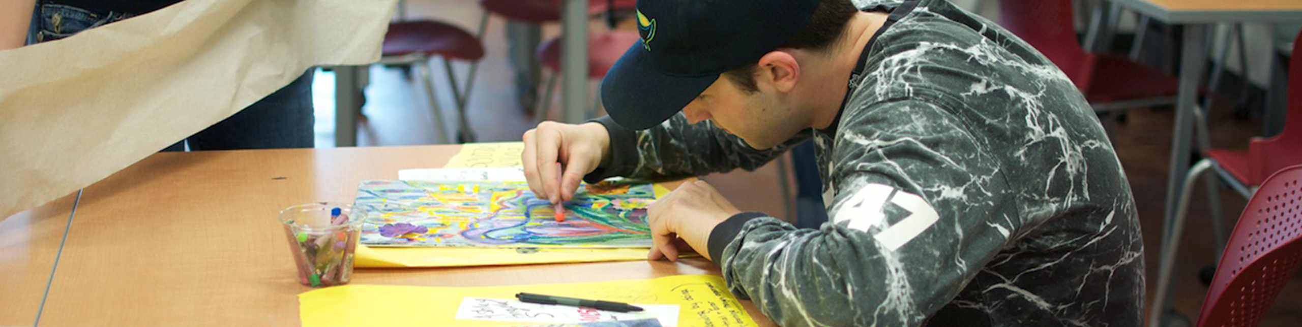 student drawing a picture