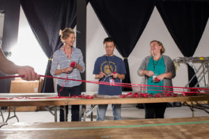 Patterson worked with volunteers to cut more than 24 miles of satin ribbon for her installation. Photo courtesy of The Ringling.