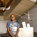 Isiah Taylor with his airline sculptures in Honest Visions