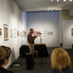 HV8 Mathieu Frederickson reading poetry during the Honest Visions performance evening.