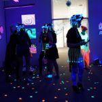 Blacklight dancers getting ready for a performance at the opening.