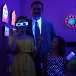 Visitors to the Artists' League Blacklight Guild installation.