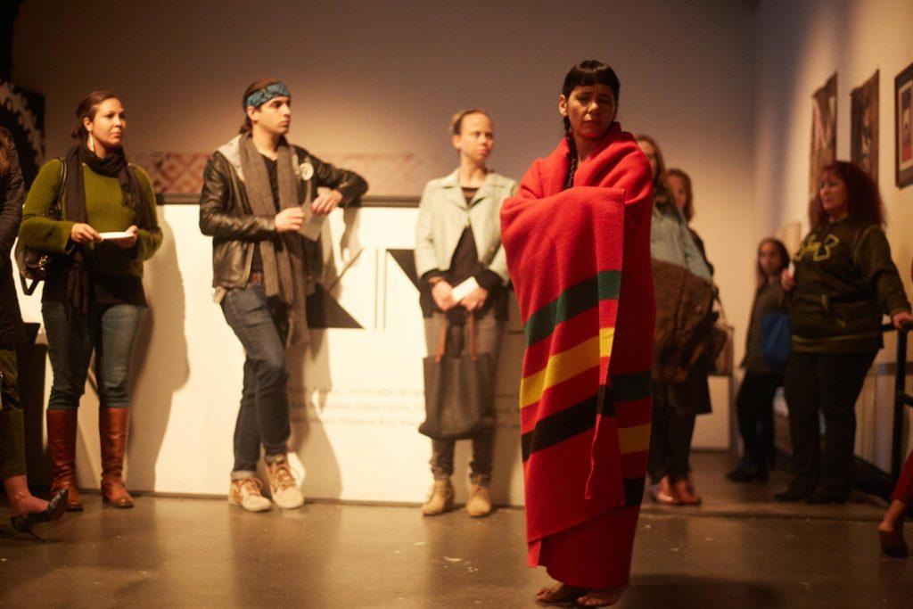 Rosy Simas performs Skin(s). Photo by Uche Iroegbu, courtesy of Intermedia Arts.