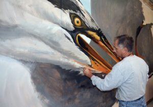 "Artist Michael Rosato painting a mural entitled ""Big Bird"" in his studio in Cambridge, Maryland. Rosato is a 1983 graduate of Florida State University. (Photo: Special to the Democrat)"