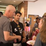 associate dean shamp with students